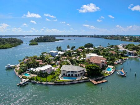 Aerial view of Bay Island neighborhood, luxury villas and boat, in Sarasota, Florida, USA