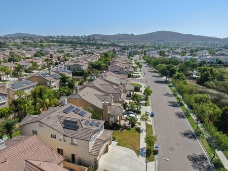 Suburban neighborhood street with big villas next to each other in Black Mountain, San Diego, California, USA. Aerial view of residential modern subdivision luxury house. 免版税图像