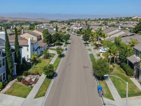 Suburban neighborhood street with big villas next to each other in Black Mountain, San Diego, California, USA. Aerial view of residential modern subdivision luxury house. 스톡 콘텐츠
