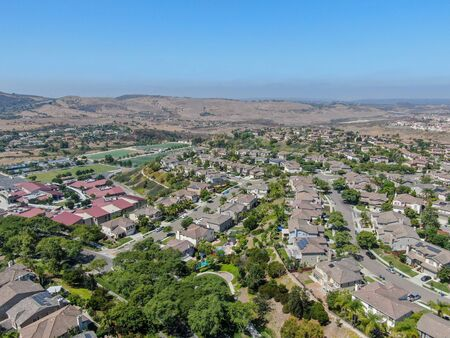 Aerial view suburban neighborhood with big villas next to each other in Black Mountain, San Diego, California, USA. Residential modern subdivision luxury house.