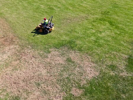 Aerial view of lawn care riding mower at the square park, Ladera Ranch. california.
