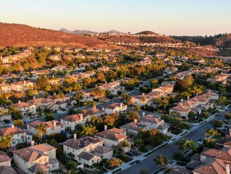Aerial view of residential modern subdivision luxury house neighborhood during sunset. South California, USA