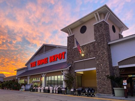 The Home Depot store entrance with colorful sunset in the background in Irvine, California, USA. Largest home improvement retailer and construction service in the US. November, 22nd, 2019