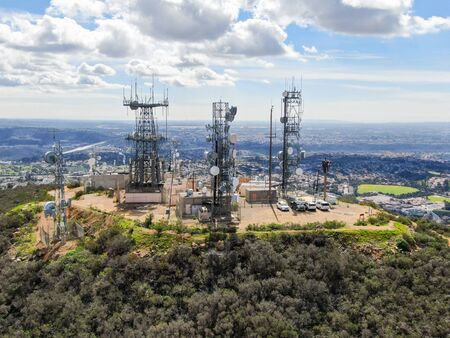 Aerial view of telecommunication antennas on the top of Mountain, SD, California, USA. Television, radio and communications antenna with numerous transmitters, Technology.
