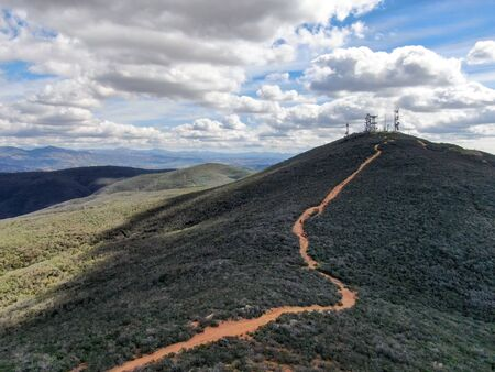 Aerial view of telecommunication antennas on the top of Mountain, SD, California, USA. Television, radio and communications antenna with numerous transmitters, Technology. Stock Photo