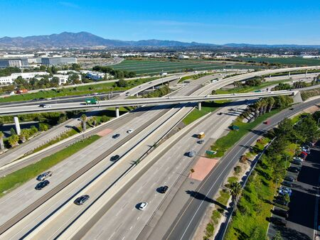 Aerial view of highway transportation with small traffic, highway interchange and junction, San Diego Freeway and Santa Ana Freeway. USU California