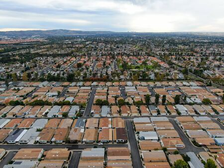 Aerial view of urban sprawl. Suburban packed homes neighborhood with road.during clouded day. Vast subdivision in Irvine, California, USA Stock fotó