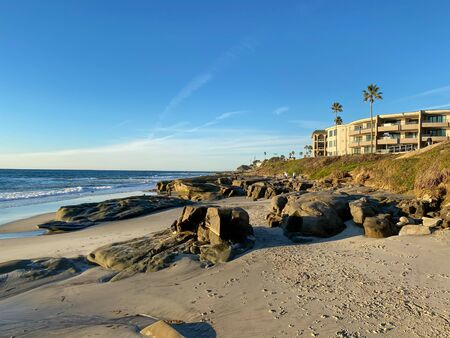 La Jolla shores and beach with building on the background in La Jolla San Diego, Southern California Coast. USA. Blue waters of the Pacific Ocean Coastline