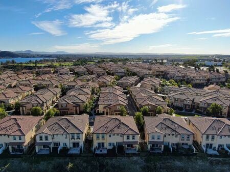 Aerial view of upper middle class neighborhood with identical residential subdivision houses during sunny day in Chula Vista, California, USA. Stock fotó
