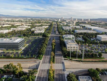 Aerial view of business and finance district with new office building surrounded by parking and road. Irvine Business Complex. Irvine California. USA