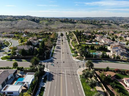 Aerial view of small neighborhood road with residential modern subdivision luxury houses in Chula Vista, California, USA.