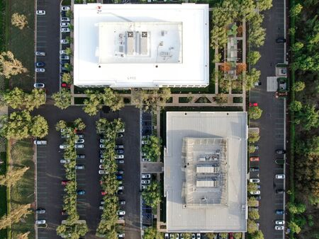 Aerial top view of offices and business building with parking in Irvine business area. Irvine California. USA