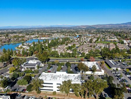 Aerial view of North Lake surrounded by residential neighborhood during blue sky day in Irvine, Orange County, USA