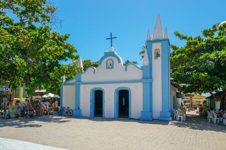 February  22nd, 2019: Church of Sao Francisco De Assis. Little church in the middle of the village of Praia Do Forte, Famous tourist attraction in state of Bahia, Brazil. Zdjęcie Seryjne - 138487185