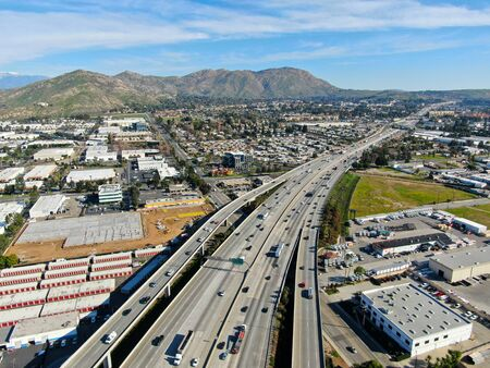 Aerial view of highway transportation with small traffic, highway interchange and junction, Riverside, California, USA
