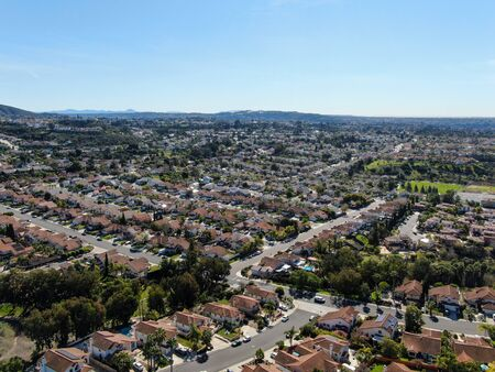 Aerial view of typical suburban neighborhood with big villas next to each other during sunny day, San Diego, California, USA. Reklamní fotografie