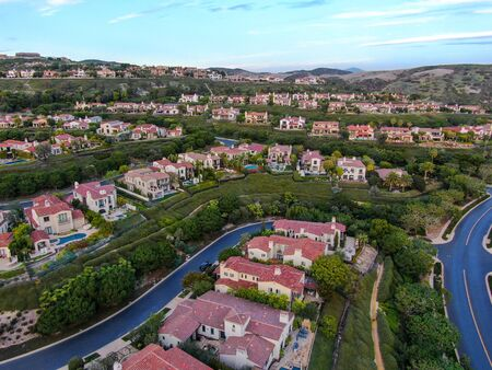 Crystal Cove neighborhood community in the Newport coast before sunset. Luxury big villa with pool on the cove.