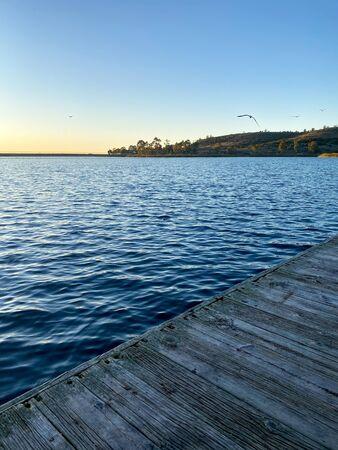 little wood pier at Miramar lake before sunset twilight. San Diego, California, USA.