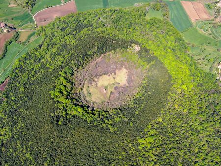 The Santa Margarida Volcano is an extinct volcano in the comarca of Garrotxa, Catalonia, Spain. The volcano has a perimeter of 2 km and a height of 682 meters in Garrotxa Volcanic Zone Natural Park