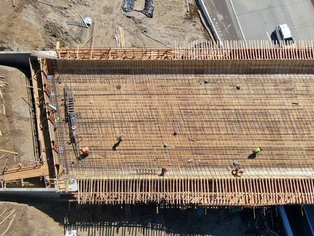 Aerial view of bridge construction crossing the highway, California, USA Stock Photo