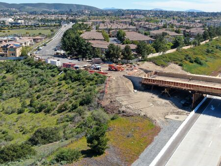 Aerial view of bridge construction crossing the highway, California, USA