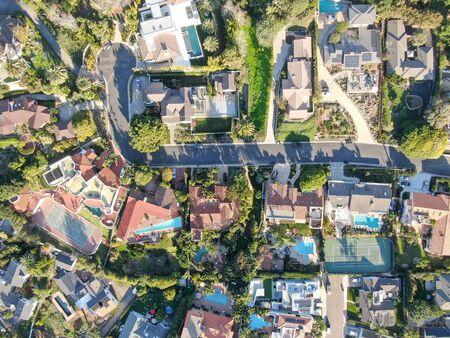 Aerial view of La Jolla little coastline city with wealthy villas and swimming pool. La Jolla, San Diego, California, USA. West coast real estate development.