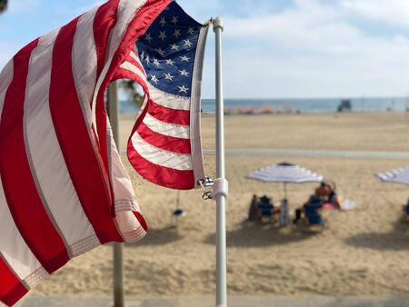 American flag with the beach on the background in Santa Monica beach, California, USA. Archivio Fotografico - 142735901