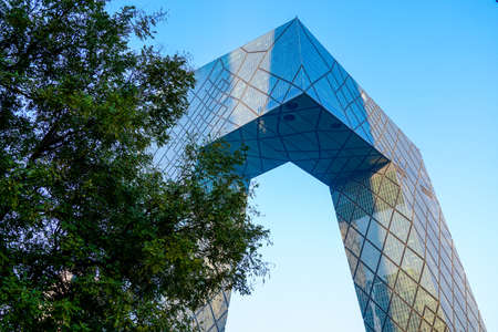 The CCTV Tower of Beijing, China. CCTV Headquarters during blue day in Beijing, The CCTV building is a loop of six horizontal and vertical sections with a total floor space of 473,000 sq. April 4th, 2020