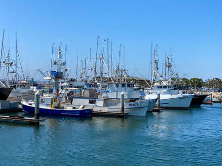 Commercial Fishing Boats Docked in San Diego Harbor with blue sky. Fish Harbor Pier Located in the downtown area of San Diego adjacent to seaport village. California, USA. April, 18th,2020 Editorial