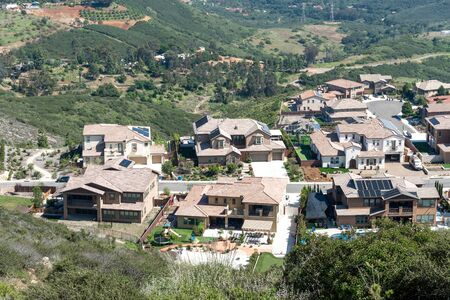 Aerial view of upper middle class neighborhood with big villas around Double Peak Park in San Marcos, California, USA.