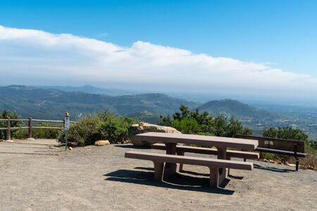 Resting area with bench on the top of the Double Peak Park in San Marcos. 200 acre park featuring a play area and hiking trails that lead to a summit.