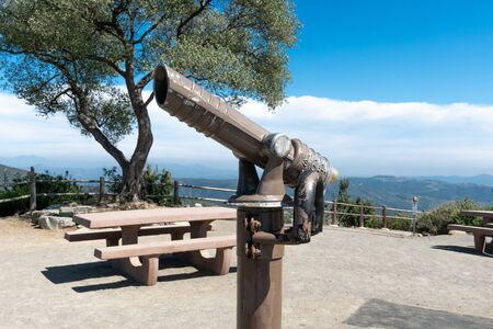 Telescope on the summit of the Double Peak Park in San Marcos. 200 acre park featuring a play area and hiking trails that lead to a summit.