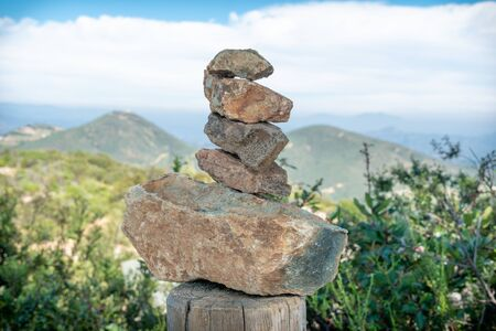 Balancing and concentration zen pile of rocks. Relaxation and meditation through simplicity harmony and rock balance lead to health and wellness. Pile of rocks made on the top of the mountain.