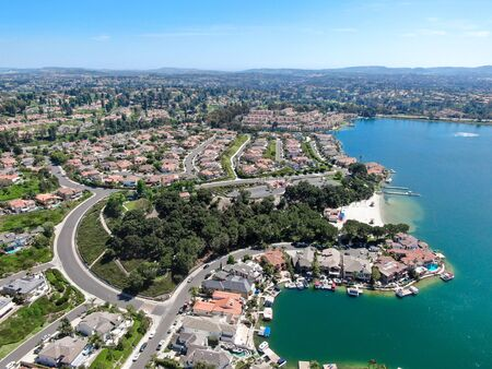 Aerial view of Lake Mission Viejo, with recreational facilities, surrounded by private residential and condominium communities. Orange County, California, USA Foto de archivo