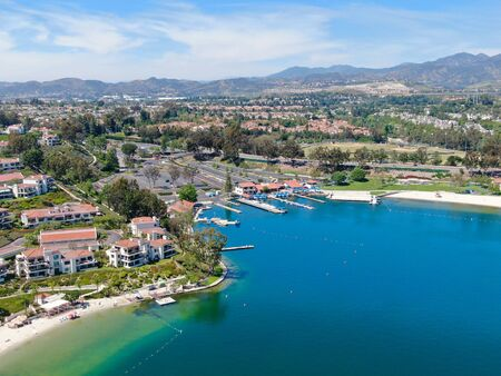 Aerial view of Lake Mission Viejo, with recreational facilities, surrounded by private residential and condominium communities. Orange County, California, USA