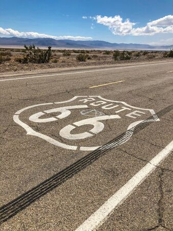 The famous Route 66 emblem painted on Route 66 in the California Desert. USA Фото со стока