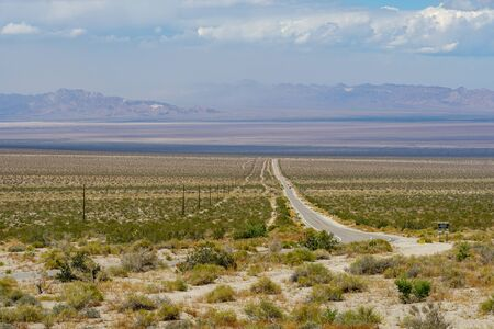 Endless desert road. Long straight road in desert. Adventure travel in a desert. California. USA