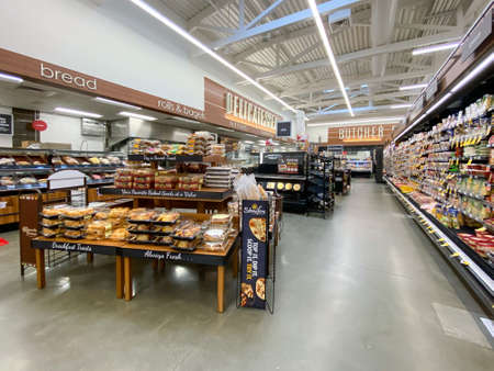 Interior view of a supermarket with aisle with shelves full of bakery variety of products, Vons supermarket, Catalina, USA, June 20th, 2020