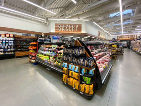 Interior view of a supermarket with aisle with shelves full of fruit and vegetable variety of products, Vons supermarket, Catalina, USA, June 20th, 2020 Editorial