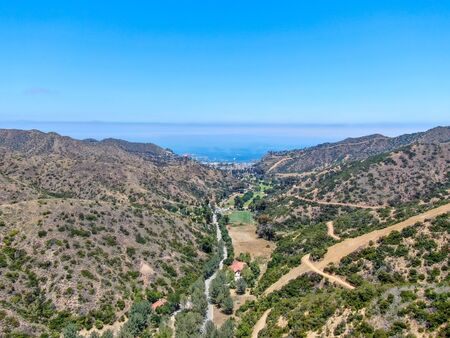 Aerial view of Santa Catalina Island mountains and trails with ocean on the background. California, USA