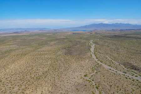 Aerial view of desert next the Lake Mead in Mohave County, Arizona, United States. Arid endless desert during hot summer season