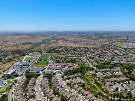 Aerial view of suburban neighborhood with big mansions in San Diego, California, USA. Aerial view of residential modern subdivision luxury house.