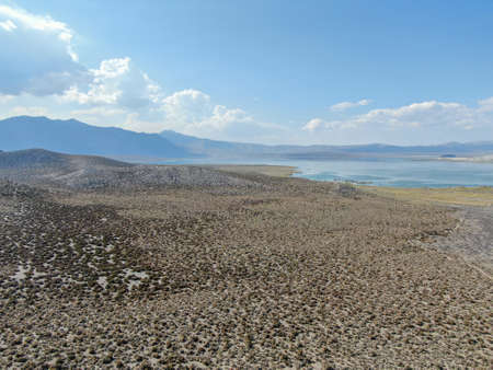 Aerial view of dusty dry desert land with Mono Lake on the background, Mono County, California, USA 写真素材