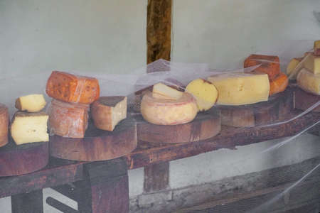 Variety of traditional cheese in a cheese farm store, dry aged cheeses Reklamní fotografie