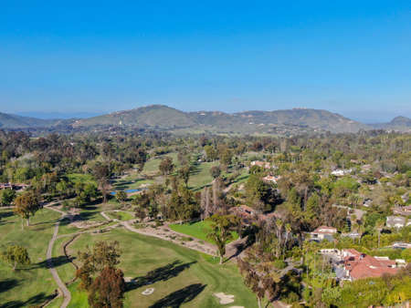 Aerial view over golf field. Large and green turf golf course in South California. USA