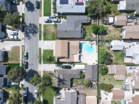 Aerial top view of Lakewood middle class neighborhood houses, city in Los Angeles County, California, United States.