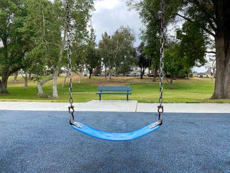 Swings at children playground activities in public park. swing on modern playground. Urban neighborhood childhood concept. Archivio Fotografico