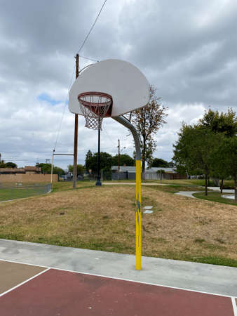 Recreational facilities with basketball court in residential community park in Placentia, California