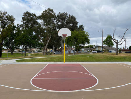 Recreational facilities with basketball court in residential community park in Placentia, California, USA. June 16th, 2021