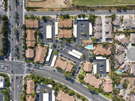 Aerial top view of San Marcos neighborhood with houses and street during sunny day, California, USA.